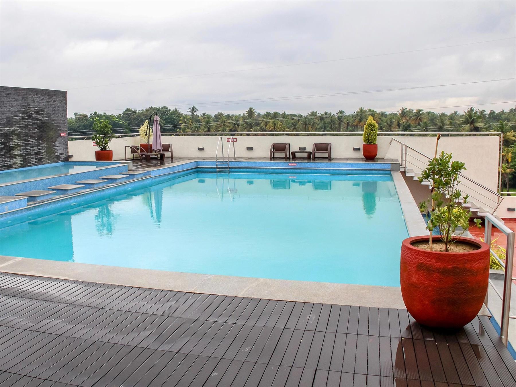 Hotel near domastic airport hotel hotel near by airport veg hotel - Flora Airport Hotel