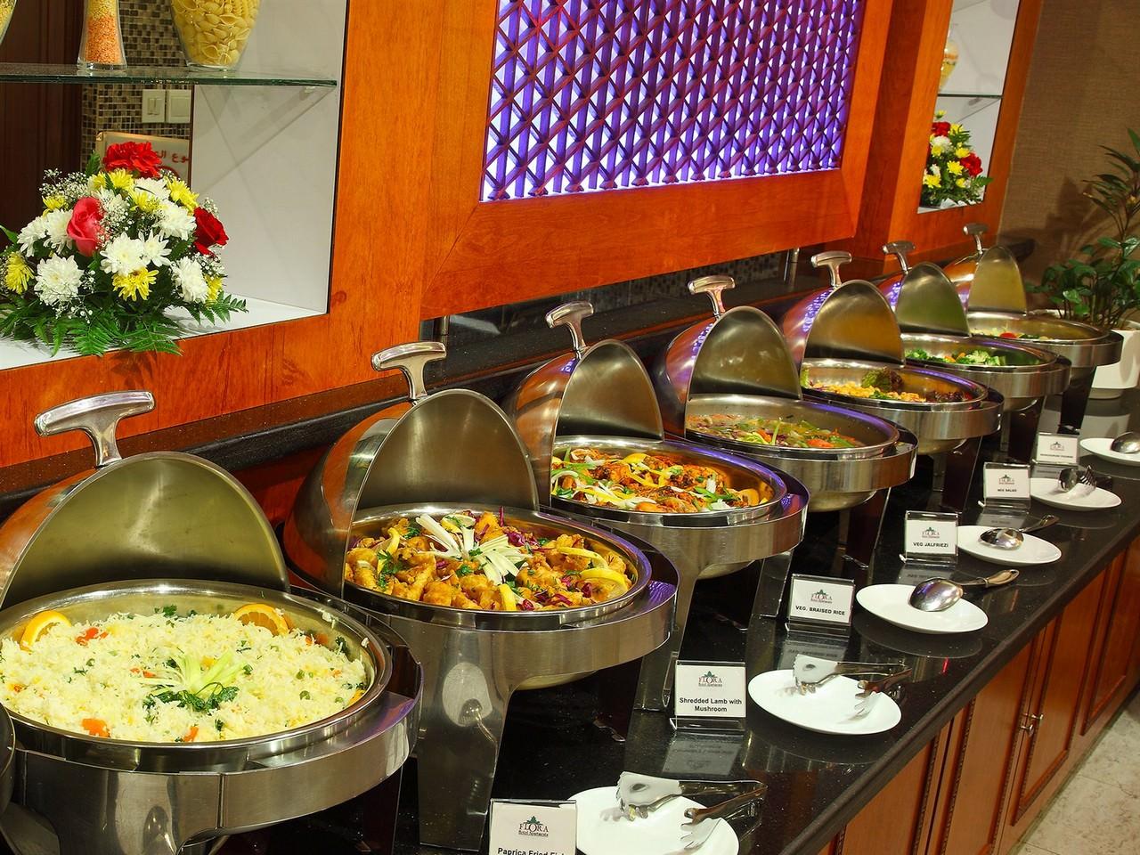 Flora hotel apts official site nasser square deira dubai for Hotel restaurant